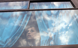 October 19, 2016 - Rafah, Gaza Strip - Palestinian girl looks out window of bus as she waits for travel permits to cross into Egypt through the Rafah border crossing after it was opened by Egyptian authorities for humanitarian cases, in Rafah. (Credit Image: © Abed Rahim Khatib/APA Images via ZUMA Wire)