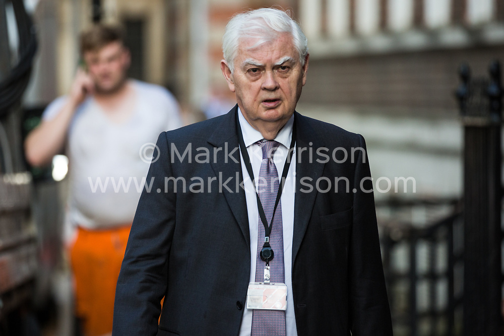 London, UK. 23 July, 2019. Norman Lamont, Baron Lamont, arrives to attend a celebration in Westminster of Boris Johnson's election as Conservative Party leader and replacement of Theresa May as Prime Minister organised by the pro-Brexit European Research Group (ERG).