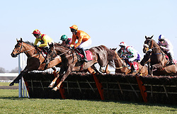 Erick Le Rouge and Chester Williams (orange colours) clear an early flight before winning The 888Sport Handicap Hurdle Race run at Kempton Park Racecourse.