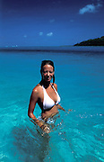 Pretty girl on the crystal clear waters of Huahine, Society islands.French Polynesia, South Pacific