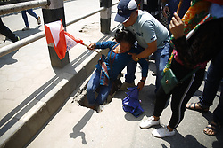May 1, 2019 - Kathmandu, Nepal - A woman falls on a pothole during a rally to celebrate Labour Day also referred as May Day in Kathmandu, Nepal on Wednesday, May 01, 2019. (Credit Image: © Skanda Gautam/ZUMA Wire)