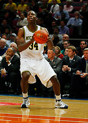 Nov 21, 2008; New York, NY, USA; Michigan Wolverines forward DeShawn Sims (34) looks to take a shot during the 2K Sports Classic Championship game against the Michigan Wolverines at Madison Square Garden. Duke won 71-56.