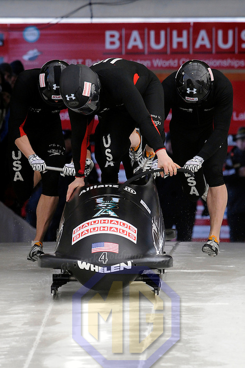 28 February 2007:    The USA 1 bobsled driven by Steven Holcomb with sidepushers Justin Olsen and Steve Mesler, and brakeman Curtis Tomasevicz jump into the sled at the start of the 2nd run at the 4-Man World Championships competition on February 27 at the Olympic Sports Complex in Lake Placid, NY.