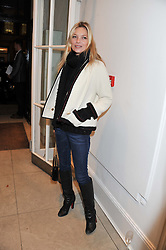 KATE MOSS at a party to celebrate the switching on of the Christmas Lights at the Stella McCartney store, Bruton Street, London on 29th November 2011.