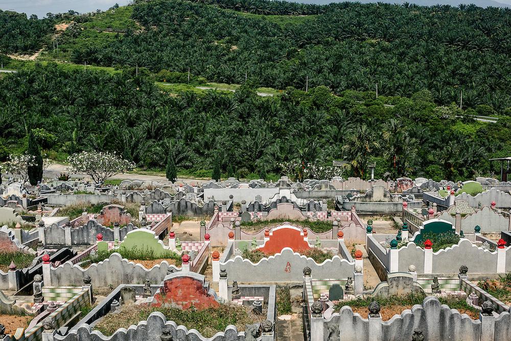 A Local Chinese Cemetery by a Palm Plantation. Sungai Pelek, Selangor, Malaysia.