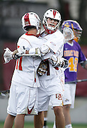 SHOT 5/11/13 6:24:14 PM - Denver's Wesley Berg #14 gets hug from teammate Eric Law #11 after scoring one of his eight goals against Albany during their first round NCAA Tournament lacrosse game at the Peter Barton Lacrosse Stadium on the University of Denver campus Saturday May 11, 2013. The University of Denver won the game 19-14 to advance. (Photo by Marc Piscotty / © 2013)