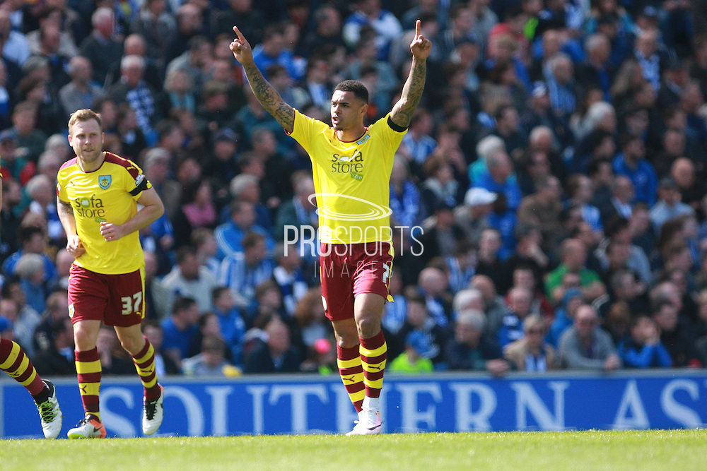 Burnley striker Andre Gray celebrates after making it 1-1 during the Sky Bet Championship match between Brighton and Hove Albion and Burnley at the American Express Community Stadium, Brighton and Hove, England on 2 April 2016. Photo by Bennett Dean.