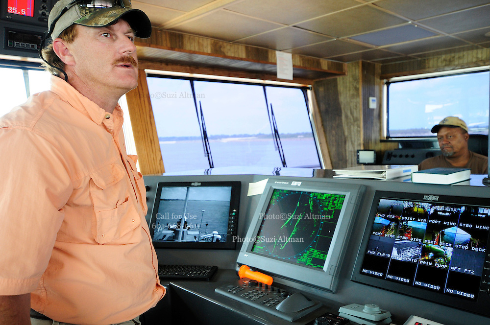 {8/24/12} {10pmCST} -JOB # 42286- Greenville , MS, U.S.A. --Charles F. Ashley ,Asst. Master, of the Dredge JADWIN, of the US Army Corp of Engineers, watches as the dredging begins 7miles downriver from Greenville MS. where the Army Corp of Engeineers is dredging the river to keep it open to tug boat traffic. Sandbars creep up as the water level drops on the Mississippi River makeing navigating the Mississippi River difficult for tug boat captains Ron Mook , Friday August 24,2012. Historically low river levels on the Mississippi River are causing havoc on river traffic: grounding barges loaded with grain and fertilizer, traffic jams several miles long and forcing the Coast Guard to close down chunks of the river due to groundings. The area around Greenville, Miss., has closed three times the past week due to groundings. Last year, there were five total groundings the entire low-water season. Locals who fought historic high-water floods last year are this year engaged in a different fight: keeping barges afloat on a vanishing Mississippi.  -- Photo by Suzi Altman, Freelance.