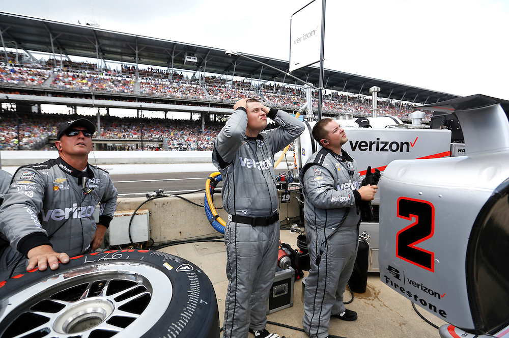 A crew member for Juan Pablo Montoya reacts after Montoya crashed during the 100th running of the Indianapolis 500 May 29, 2016.