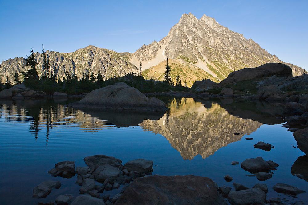 Mount Stuart reflected in still water of Ingalls Lake Central Cascades Washington USA