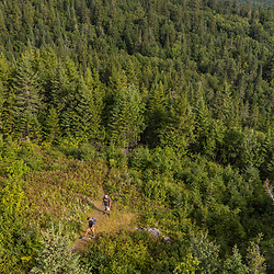 Hikers near the fire tower on Deboullie Mountain in Aroostook County, Maine. Deboullie Public Reserve Land.