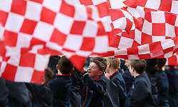 """Stoke City's young flag bearers wave their Stoke City flags during the Premier League match at the bet365 Stadium, Stoke. PRESS ASSOCIATION Photo. Picture date: Saturday April 15, 2017. See PA story SOCCER Stoke. Photo credit should read: Barrington Coombs/PA Wire. RESTRICTIONS: EDITORIAL USE ONLY No use with unauthorised audio, video, data, fixture lists, club/league logos or """"live"""" services. Online in-match use limited to 75 images, no video emulation. No use in betting, games or single club/league/player publications."""