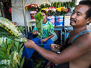 "11 JUNE 2015 - MAHACHAI, SAMUT SAKHON, THAILAND:  Burmese migrant workers who work in a florist shop package flowers in Samut Sakhon. Labor activists say there are about 200,000 migrant workers from Myanmar (Burma) employed in the fishing and seafood industry in Mahachai, a fishing port about an hour southwest of Bangkok. Since 2014, Thailand has been a Tier 3 country on the US Department of State Trafficking in Persons Report (TIPS). Tier 3 is the worst ranking, being a Tier 3 country on the list can lead to sanctions. Tier 3 countries are ""Countries whose governments do not fully comply with the minimum standards and are not making significant efforts to do so."" After being placed on the Tier 3 list, the Thai government cracked down on human trafficking and has taken steps to improve its ranking on the list. The 2015 TIPS report should be released in about two weeks. Thailand is hoping that its efforts will get it removed from Tier 3 status and promoted to Tier 2 status.       PHOTO BY JACK KURTZ"
