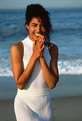 Woman with a big smile  at the beach