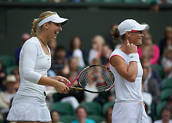LONDON, ENGLAND - Saturday, July 2, 2011: Sabine Lisicki (GER) and Samantha Stosur (AUS) in action during the Ladies' Doubles Final match on day twelve of the Wimbledon Lawn Tennis Championships at the All England Lawn Tennis and Croquet Club. (Pic by David Rawcliffe/Propaganda)