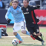NEW YORK, NEW YORK - March 12:  Nick DeLeon #14 of D.C. United is challenged by Thomas McNamara #15 of New York City FC during the NYCFC Vs D.C. United regular season MLS game at Yankee Stadium on March 12, 2017 in New York City. (Photo by Tim Clayton/Corbis via Getty Images)