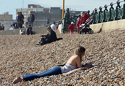 A visitor takes to the beach as spring finally arrived in Brighton ,Sunday 14th April 2013 Photo by: Stephen Lock / i-Images