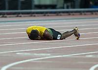 Athletics - 2017 IAAF London World Athletics Championships - Day Nine, Evening Session<br /> <br /> Mens 4 x 100m Relay<br /> <br /> Usain Bolt (Jamaica) collapses on the track after he sees his dream shattered as he pulls up injured coming down the home straight at the London Stadium<br /> <br /> COLORSPORT/DANIEL BEARHAM