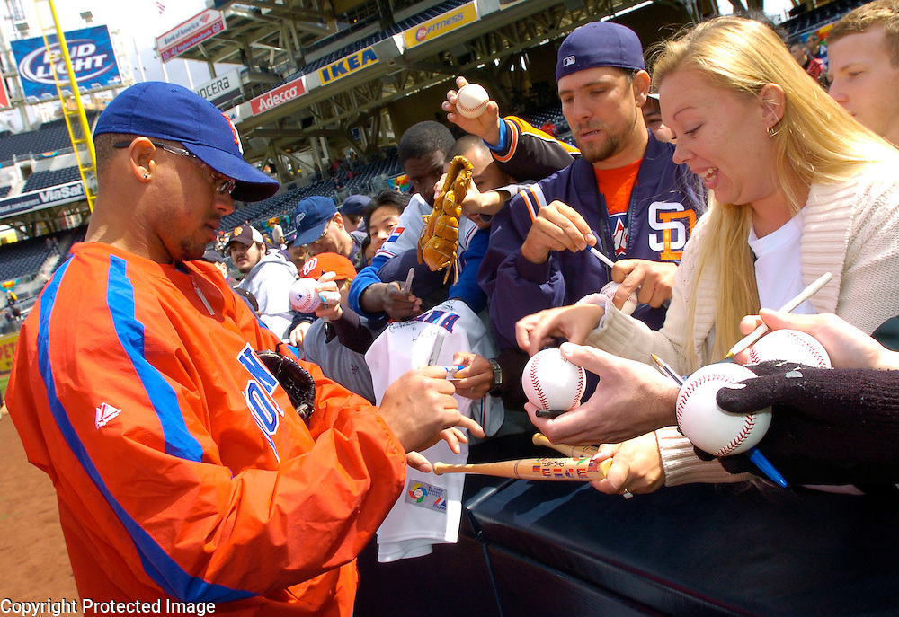 Team Dominican Republic's Duaner Sanchez signing autographs before the start of the game against Team Cuba in Semi-Final action of the World Baseball Classic at PETCO Park, San Diego, CA.
