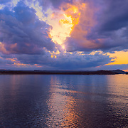 """""""Dream Weaver"""" <br /> <br /> Beautiful dramatic clouds in shades of purple and gold at sunset. Lake Superior is lit up with reflections of the sky!"""