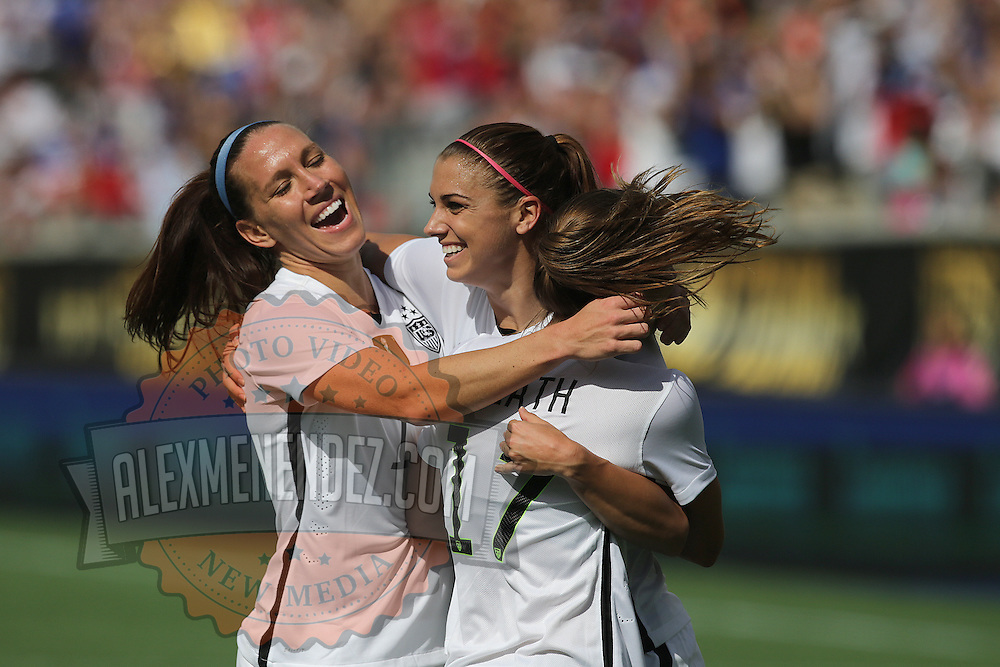 ORLANDO, FL - OCTOBER 25: Lauren Holiday #12, Alex Morgan #13, and Tobin Heath #17 of USWNT celebrate a goal during a women's international friendly soccer match between Brazil and the United States at the Orlando Citrus Bowl on October 25, 2015 in Orlando, Florida. (Photo by Alex Menendez/Getty Images) *** Local Caption *** Lauren Holiday; Alex Morgan; Tobin Heath