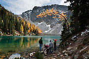 Larch tree needles turn yellow in the first half of October on Blue Lake Trail #314, Okanagon National Forest, North Cascades Highway 20, Washington, USA. Cornice Peak rises at the head of Blue Lake. Published on a full page in a visitors guide by SagaCity Media, 2012.