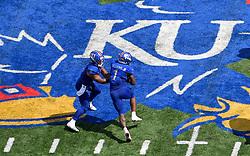 Sep 15, 2018; Lawrence, KS, USA; Kansas Jayhawks quarterback Miles Kendrick (8) hands off to running back Pooka Williams Jr. (1) during the second half against the Rutgers Scarlet Knights at Memorial Stadium. Kansas won 55-14. Mandatory Credit: Denny Medley-USA TODAY Sports