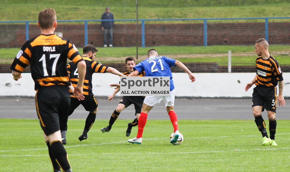 #21 Craig Johnston for Cowdenbeath trying to get past Alloa #4 Ben Gordon