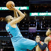 01 November 2015: Charlotte Hornets forward Nicolas Batum (5) takes a jump shot over Atlanta Hawks guard Kent Bazemore (24) during the Atlanta Hawks 94-92 victory over the Charlotte Hornets, at the Time Warner Cable Arena, in Charlotte, North Carolina, USA.