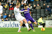 Charlton Athletic midfielder Andrew Crofts (8) clears the ball under pressure from Milton Keynes Dons midfielder Ben Reeves (10) during the EFL Sky Bet League 1 match between Milton Keynes Dons and Charlton Athletic at stadium:mk, Milton Keynes, England on 26 December 2016. Photo by Dennis Goodwin.