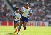Samoa Paul Perez running with the ball during the Rugby World Cup 2015 match between Samoa and USA at the Brighton Community Stadium, Falmer, United Kingdom on 20 September 2015.