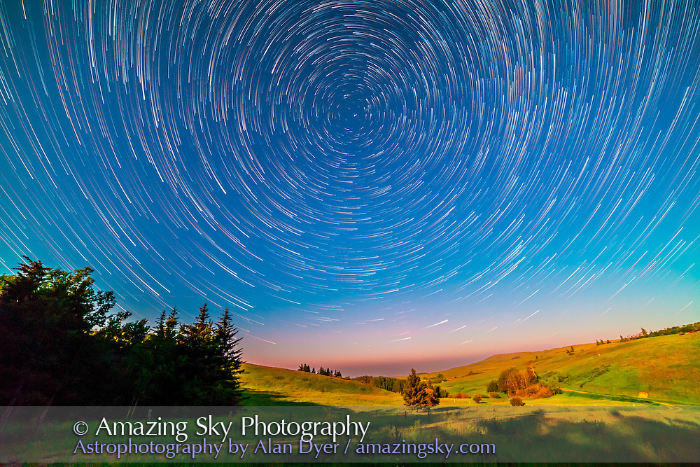 Stars wheeling about the North Celestial Pole, and Polaris, in a composite stack of 100 frames shot July 8, 2014 as part of a time-lapse sequence but here stacked with StarStax with the Comet effect mode. The landscape is from one frame to capture the lighting from the Moon at one instant rather than blurring the lighting over an hour or so of motion. Each frame taken with the Canon 5D MkII and 14mm Rokinon lens at f/2.8 for 20 seconds at ISO 2000.