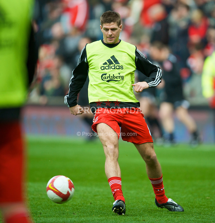 LIVERPOOL, ENGLAND - Sunday, March 22, 2009: Liverpool's captain Steven Gerrard MBE warms up before his side's Premiership match against Aston Villa at Anfield. (Photo by David Rawcliffe/Propaganda)