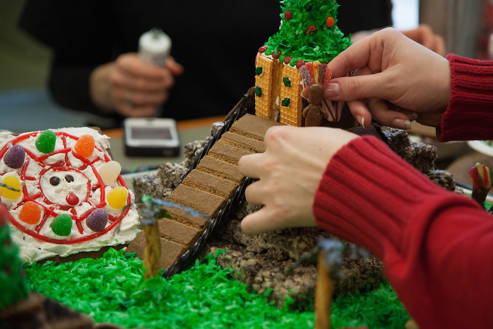 Office of Education Abroad team members prepare their entry for this year's gingerbread house decorating competition.