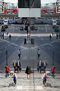 An aerial cityscape of Londoners and traffic on Upper Thames Street (upstream from London Bridge) in the City of London - the capital's financial district, on 11th October 2018, in London, England.