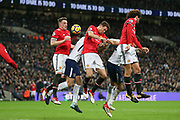 Manchester United Midfielder Nemanja Matic, Manchester United Midfielder Marouane Fellaini and Manchester United Defender Phil Jones jump in the air to clear the ball during the Premier League match between Tottenham Hotspur and Manchester United at Wembley Stadium, London, England on 31 January 2018. Photo by Phil Duncan.