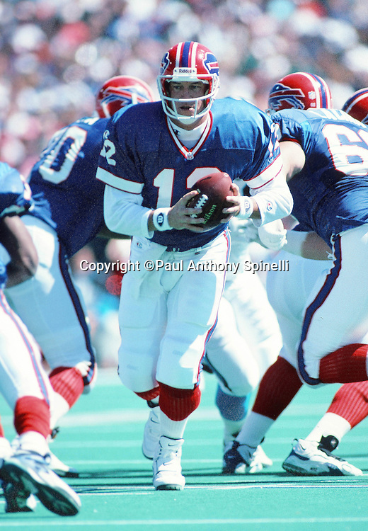 Buffalo Bills quarterback Jim Kelly (12) looks to hand off the ball on a running play during the NFL football game against the Carolina Panthers on Sept. 10, 1995 in Orchard Park, N.Y. The Bills won the game 31-9. (©Paul Anthony Spinelli)