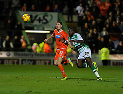 Yeovil Town's Ishmael Miller chases down the ball with Blackpool's Chris Basham - Photo mandatory by-line: Dougie Allward/JMP - Tel: Mobile: 07966 386802 03/12/2013 - SPORT - Football - Yeovil - Huish Park - Yeovil Town v Blackpool - Sky Bet Championship