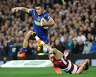 Bryson Goodwin of Warrington Wolves swats Oliver Gildart of Wigan Warriors away during the Betfred Super League Grand Final match at Old Trafford, Manchester.<br /> Picture by Michael Sedgwick/Focus Images Ltd +44 7900 363072<br /> 13/10/2018