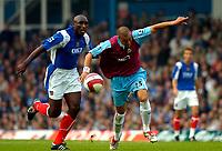 Photo: Alan Crowhurst.<br />Portsmouth v West Ham United. The Barclays Premiership. 14/10/2006. West Ham's Bobby Zamora (R) takes on Sol Campbell.