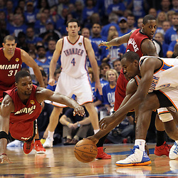 Jun 12, 2012; Oklahoma City, OK, USA;  Miami Heat power forward Chris Bosh (1) and Oklahoma City Thunder center Kendrick Perkins (5) battle for a loose ball during the first quarter of game one in the 2012 NBA Finals at the Chesapeake Energy Arena.  Mandatory Credit: Derick E. Hingle-USA TODAY SPORTS