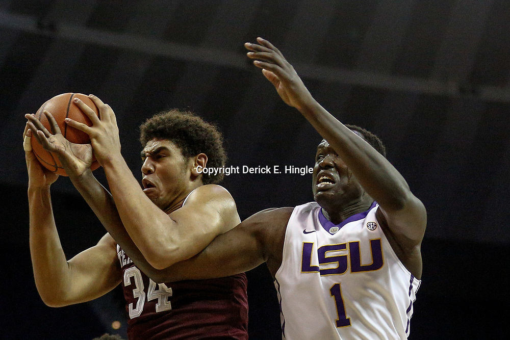 Feb 4, 2017; Baton Rouge, LA, USA; Texas A&M Aggies center Tyler Davis (34) rebounds over LSU Tigers forward Duop Reath (1) during the first half at the Pete Maravich Assembly Center. Mandatory Credit: Derick E. Hingle-USA TODAY Sports