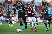 Liverpool defender Virgil van Dijk (4) covers off the attack from Burnley forward Jay Rodriguez (19) during the Premier League match between Burnley and Liverpool at Turf Moor, Burnley, England on 31 August 2019.
