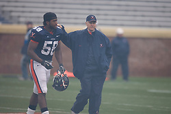 Virginia Cavaliers LB Antonio Appleby (58) is congratulated by coach Al Groh after being announced as a captain for 2007.  The University of Virginia Football Team played their Spring game at Scott Stadium in Charlottesville, VA on April 14, 2007.