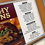 Sign in window of fast food chain with 15 of more stores have to post calories of different food items in New York City
