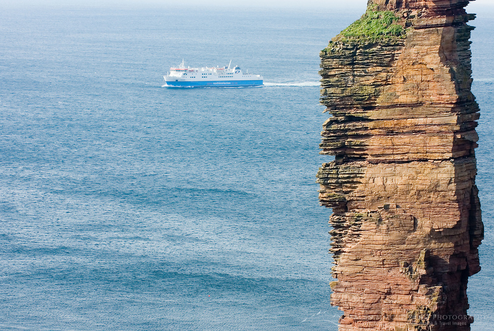 North Link ferry passing The Old Man Of Hoy a 450' tall sea stack on the Isle of Hoy Orkney Islands Scotland