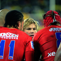 Faf de Klerk talks to his teammates during the Super Rugby final match between the Hurricanes and Lions at Westpac Stadium, Wellington, New Zealand on Saturday, 6 August 2016. Photo: Dave Lintott / lintottphoto.co.nz