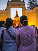 """31 JANUARY 2013 - PHNOM PENH, CAMBODIA:   Cambodian mourners look at former King Norodom Sihanouk's crematorium at the National Museum in Phnom Penh. Norodom Sihanouk (31 October 1922- 15 October 2012) was the King of Cambodia from 1941 to 1955 and again from 1993 to 2004. He was the effective ruler of Cambodia from 1953 to 1970. After his second abdication in 2004, he was given the honorific of """"The King-Father of Cambodia."""" Sihanouk served two terms as king, two as sovereign prince, one as president, two as prime minister, as well as numerous positions as leader of various governments-in-exile. He served as puppet head of state for the Khmer Rouge government in 1975-1976. Most of these positions were only honorific, including the last position as constitutional king of Cambodia. Sihanouk's actual period of effective rule over Cambodia was from 9 November 1953, when Cambodia gained its independence from France, until 18 March 1970, when General Lon Nol and the National Assembly deposed him. Upon his final abdication, the Cambodian throne council appointed Norodom Sihamoni, one of Sihanouk's sons, as the new king. Sihanouk died in Beijing, China, where he was receiving medical care, on Oct. 15, 2012. His funeral procession, which will wind through Phnom Penh is Friday, Feb.1 and his cremation is on Feb. 4, 2013. Over a million people are expected to attend the service.   PHOTO BY JACK KURTZ"""