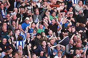 Sheffield Wednesday fans celebrate the goal scored by Sheffield Wednesday midfielder Ross Wallace during the Sky Bet Championship play-off second leg match between Brighton and Hove Albion and Sheffield Wednesday at the American Express Community Stadium, Brighton and Hove, England on 16 May 2016. Photo by Bennett Dean.