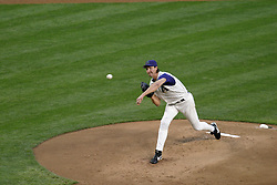 Phoenix, AZ-04-26-04 Arizona Diamondbacks pitcher Randy Johnson throws a pitch in a 9-0 shutout of the Chicago Cubs. Johnson also had a single in the 4th inning to score Bautista. Johnson is 2-2 for the season. Ross Mason photo